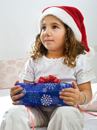 a little girl happy after reciving a christmas present Stock Photo - 3644021