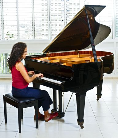 playing instrument: women pianist playing on a grand piano