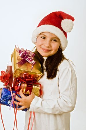 young girl with hat holding christmas presents photo