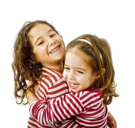 kids hugging: best friends hugging isolated on a white