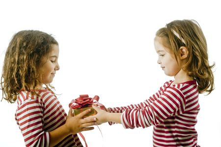two little girls giving a present isolated on white Stock Photo - 3755429