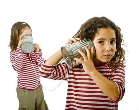 two girls talking on a tin phone isolated on white Stock Photo - 3755426