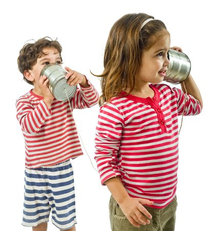 boy and girl talking on a tin phone isolated on white photo