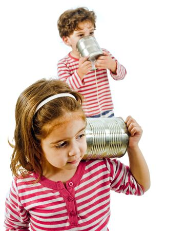 boy and girl talking on a tin phone isolated on white Stock Photo - 3755428