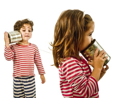 boy and girl talking on a tin phone isolated on white Stock Photo - 3755425