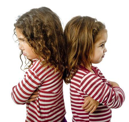 veszekedés: two little girls back to back in quarrel isolated on white
