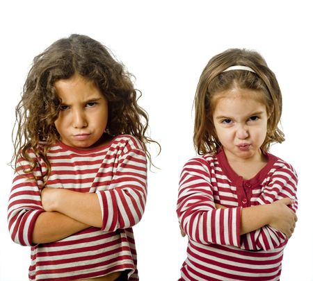 two little girls  in quarrel isolated on white photo