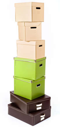 pile of boxes in different colors isolated on white photo