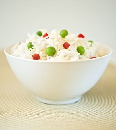 steamed: bowl of rice with peas and red peppers