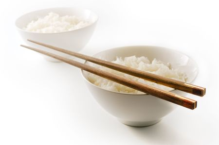 two bowls of plain rice  isolated on on white