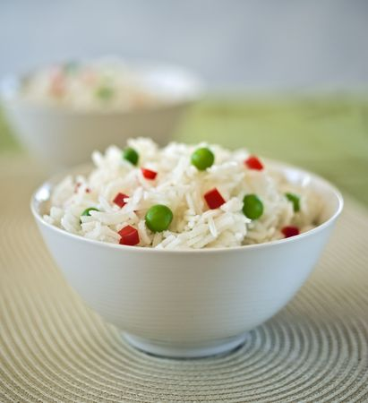 two bowls of  rice  with peas and peppers Stock Photo