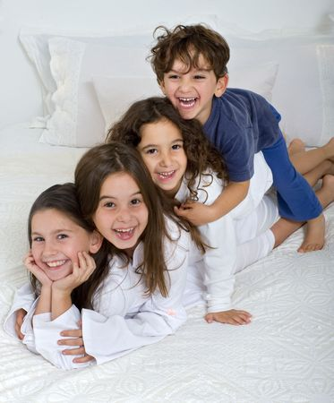four kids pield on each other photo