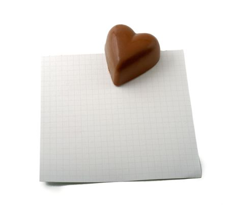 chocolate heart on a checkered note Stock Photo - 3940009