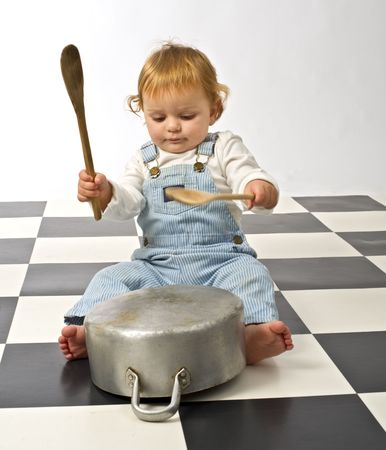 playing with spoon: little boy druming playing with pots