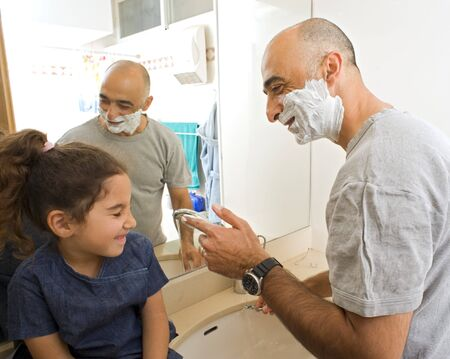 father shaving and little doughter watching in bathroom Stock Photo - 4003043