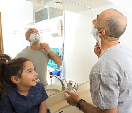 father shaving and little doughter watching in bathroom Stock Photo - 4003042