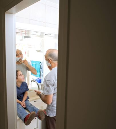 father shaving and little doughter watching in bathroom Stock Photo - 4003034