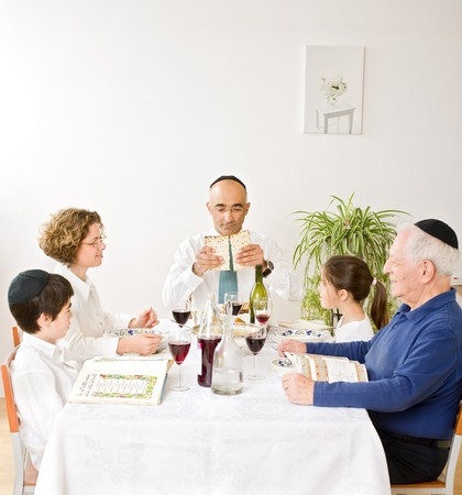 matzoh: jewish family in seder celebrating passover