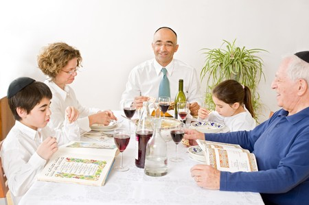 jewish home: jewish family in seder celebrating passover