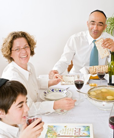 father mother and son in seder celebrating passover photo