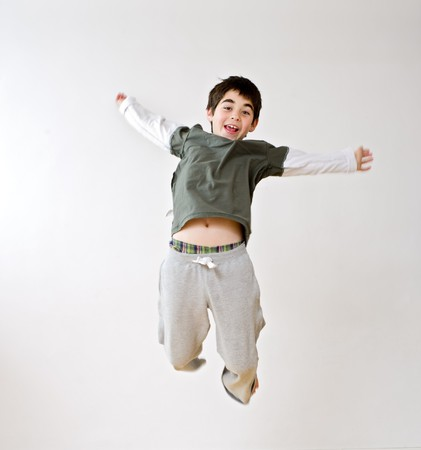 young boy jumping in the air photo