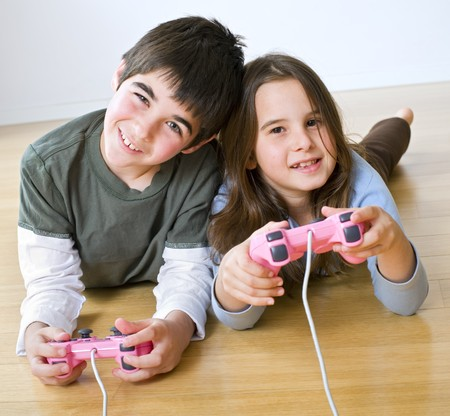 young boy and girl playing with playstation together photo