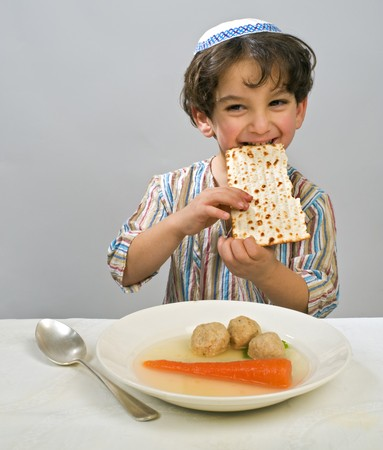 jewish ethnicity: Jwish young boy having matzo ball soup Stock Photo