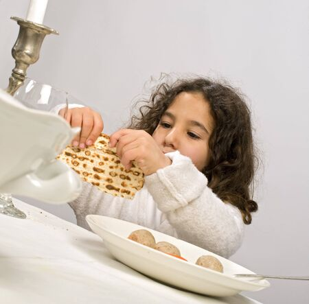 Jwish girl eating a matzo ball soup in passover Stock Photo - 4339967