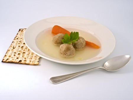 matzoh: traditional passover matzo ball soup with spone and matza. Stock Photo