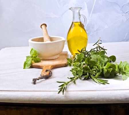 pestle mortar fresh herbs and olive oil Stock Photo - 4548302
