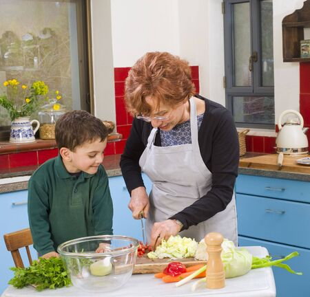 grandmother and grandson cooking in the kitchen photo