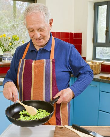 senior man cooking in his kitchen
