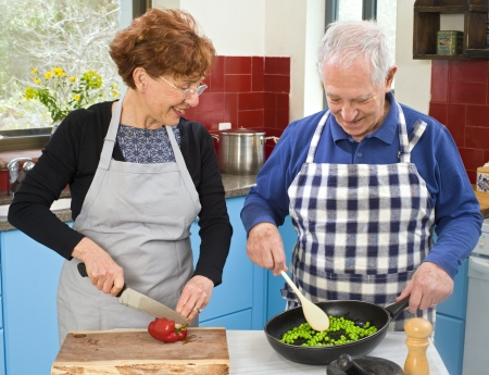 senior couple cooking at thier kitchen at home Stock Photo - 4601643