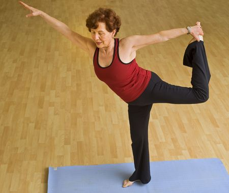 senior woman doing yoga in a gym Standard-Bild