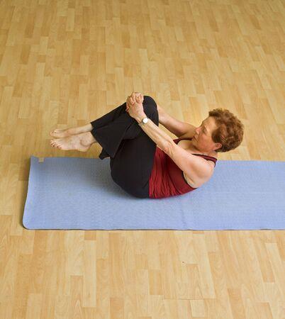 senior woman exercising in a gym photo