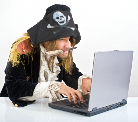 stealing: pirate attacking with a knife a laptop computer
