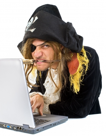 pirate attacking with a knife a laptop computer  photo