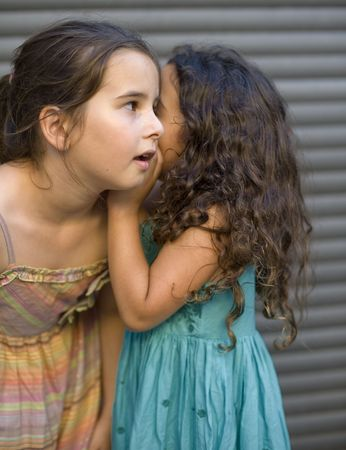 two girls telling a secret photo