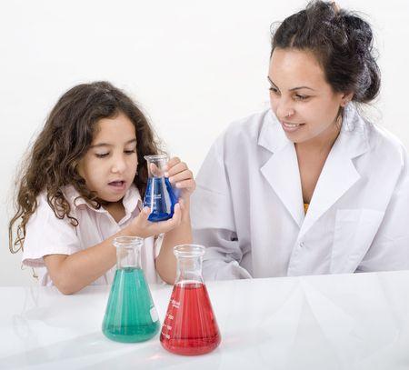 pre adult: teacher girl pupil sience class over white Stock Photo