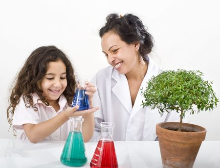 teacher girl pupil sience class small tree over white photo