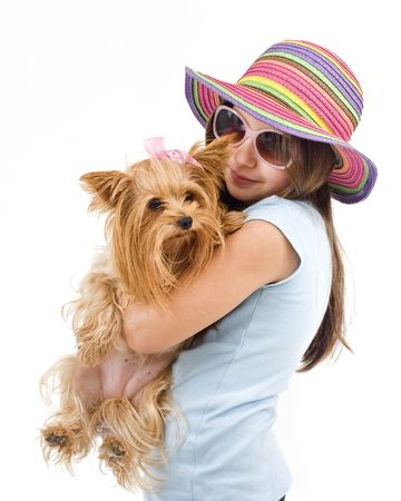 terriers: Young girl with sunglasses and hat, holding a yorkshire terrier dog