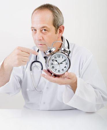 alarmclock: doctor pointing at alarmclock