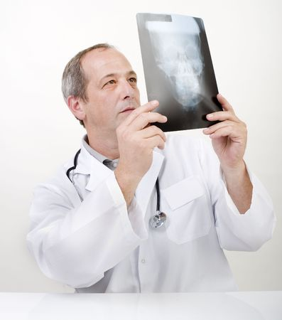 doctor looking at xray image of skull photo