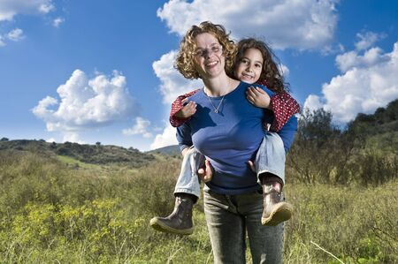 Mix race mother and child having fun outdoors photo