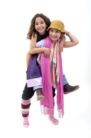Two girls piggybacking isolated on white  Stock Photo - 6163172
