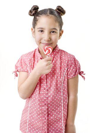 hart shaped: little girl holding an hart shaped lollipop Stock Photo