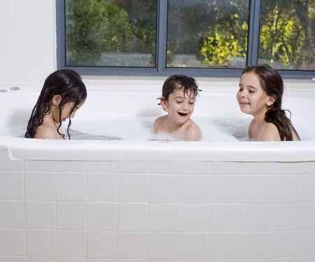 three kids having a bath together photo