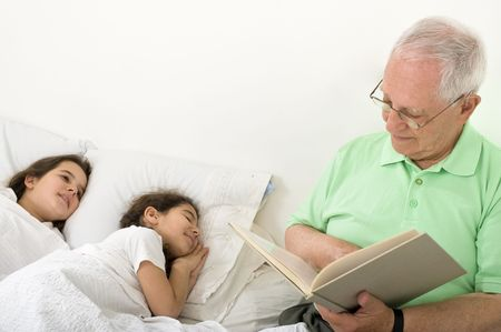 two story: grandfather reading to grandchild a bed time story