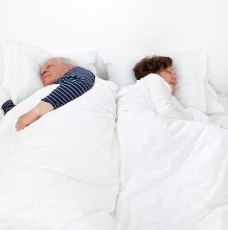 senior couple in bed asleep photo