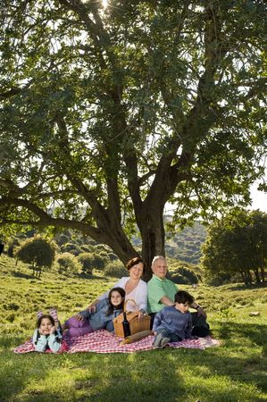 grandparents and  grandchildren having a picnic together photo